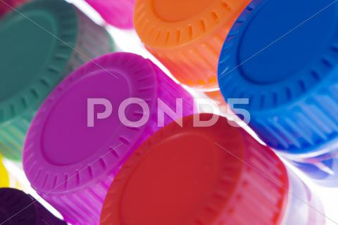 Stock photo of coloured bottle caps