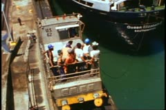 "QE2 transit of the Panama Canal, close up ""mule,"" tilt wide to stern of QE2 - stock footage"