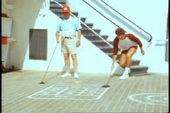 QE2 deck, medium shot, shuffleboard, two men Stock Footage