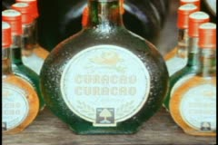Curacao, liqueur factory, close up bottles (finished goods) zoom medium Stock Footage