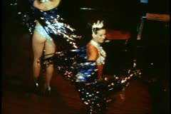 Medium close up of two showgirls dancing Stock Footage