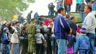 Civilian people look at military vehicles and panzers Stock Footage