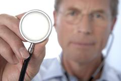 Stock Photo of doctor holding a stethoscope