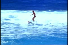 Surfing, North Shore of Oahu, big waves, one surfer, medium close up Stock Footage