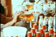 Curacao, liqueur factory, close up pour into bottles, zoom medium Stock Footage