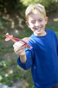 boy playing with a toy aeroplane - stock photo