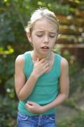 Girl coughing Stock Photos