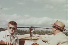 Men in motorboat - Vintage 16mm Stock Footage