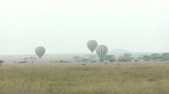 Hot air balloon in Serengeti - stock footage