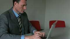 Businessman typing on a computer Stock Footage