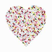 Pills and capsules in heart shape. Stock Photos