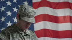Soldier in wheelchair in front of US flag, close up Stock Footage