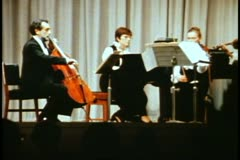 String quartet and pianist playing on stage of QE2, medium shot Stock Footage
