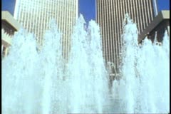 Century City, twin towers, fountain in foreground, tilt up Stock Footage