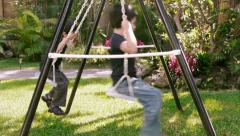 Kids Playing On Swing Side View (HD) Stock Footage