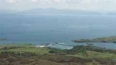 Elevated view of Galmisdale Bay Isle of Eigg Scotland Stock Footage