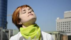 Woman breaks away from reading, to stretch the neck Stock Footage