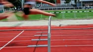 Stock Video Footage of Loop and slow motion of female sprinter jumping over the hurdle