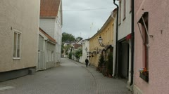 Swedish older town with cars and cobblestones - stock footage