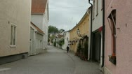 Stock Video Footage of Swedish older town with cars and cobblestones