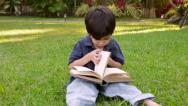 Boy Flipping Book Pages (HD) Stock Footage