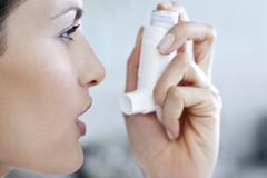 asthma inhaler use - stock photo