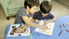 Boys Helping with Coloring Drawing (HD) - stock footage