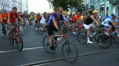 Bicyclists at fan procession Stock Footage