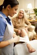 Leg ulcer treatment Stock Photos