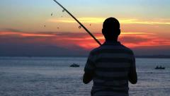 Angler fisherman trolling the rod Stock Footage