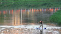 Man on water and fan procession Stock Footage