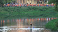 Fan procession at river Stock Footage