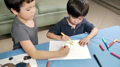 Young Boys Coloring Same Drawing Stock Footage