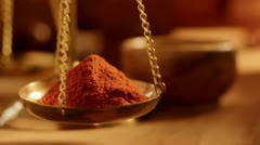 Pan across spice in weighing scales Stock Footage
