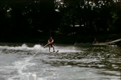 Waterskiing up a ramp - Vintage 8mm Slow Motion Stock Footage