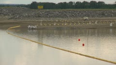 Pollution, oil boom on lake Stock Footage
