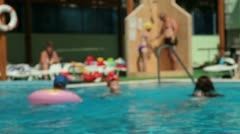 People Relaxing In Swimming Pool Stock Footage