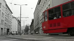 Red tram in the bw city. Stock Footage