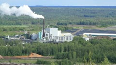 Factory bellows steam in Sweden Stock Footage