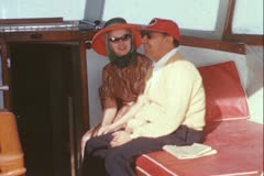 Couple sitting on a boat - Vintage 16mm Stock Footage