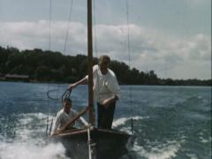 Boys sailing on lake - Vintage 16mm Stock Footage