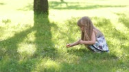 3s Happy girl picking flowers in the meadow Stock Footage