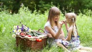 Stock Video Footage of Mother and daughter with vegetables in nature. They eating cucumbers