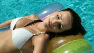 Beautiful Woman Relaxing In Pool Stock Footage