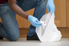 Tidying-up bloody tissue Stock Photos