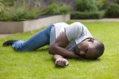 man in recovery position - stock photo