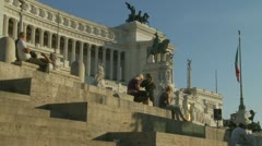 Tourists relax in the sun near Vittorio,Emanuele in Rome Stock Footage