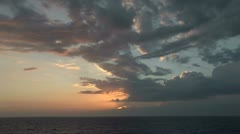 Huge clouds foster the intense Croatian sunset over the ocean - stock footage