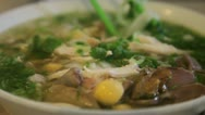 Stock Video Footage of Vietnamese Pho, with someone eating it