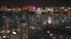 Tilt-shift aerial time-lapse shot of Tokyo's busy city roads. - stock footage